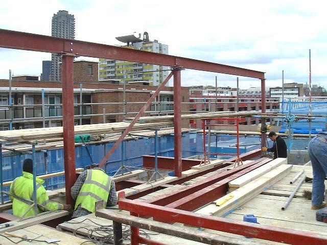 Steel frame structure above original warehouse